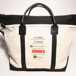 Style #1240: BankerBag tote made of 22-oz cotton canvas with pop-up zipper top, leather handles, and adjustable/removable shoulder strap. Logos in full color transfer on one side.
