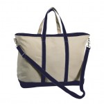 Style #1360: Canvas XL boat tote made of 26-oz cotton canvas, zippered top, removable shoulder strap, hanging interior zipper pocket, silver D-ring. Available with navy blue or black handles.