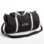 Style #2000: Classic BankerBag duffel in 18-oz cotton canvas with custom woven ribbon handles, and embroidered logo on pocket. Adjustable/removeable shoulder strap. Made in USA.