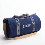 Style #2000: Classic BankerBag duffel made of 18-oz cotton canvas with custom woven ribbon handles and embroidered logo on pocket. Adjustable/removeable shoulder strap. Made in USA