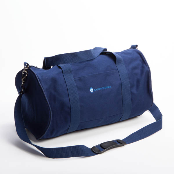 Style #2200: Standard BankerBag duffel made of 18-oz cotton canvas featuring embroidered logo on pocket. Adjustable/removeable shoulder strap. Made in USA.