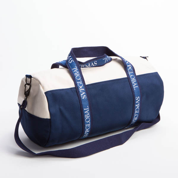 Style #2070: Two-tone BankerBag duffel made of 18-oz cotton canvas with custom woven ribbon handles and adjustable/removeable shoulder strap. Made in USA.