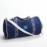 Style #2000: Classic BankerBag duffel made of 18-oz cotton canvas with custom woven ribbon handles and adjustable/removeable shoulder strap. Made in USA.
