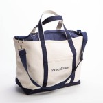 Style #1170: Classic BankerBag Tote made of heavyweight canvas with pop-up zipper top and embroidered logo on front pocket. Made in USA.